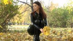 Seductive Redhead In Latex Catsuit And Balletboots Walking In Public